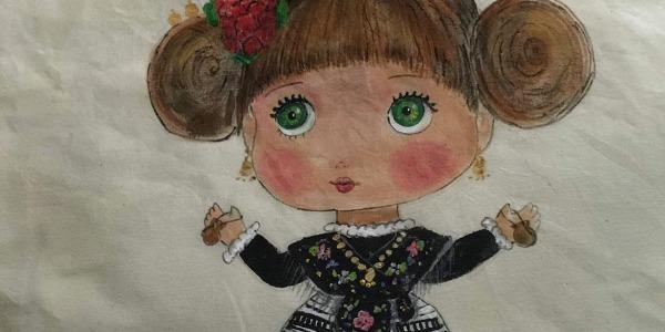 Bolso de tela cosido y decorado a mano.